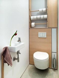 Extremely space-efficient powder room. Photography by Frederik Vercruysse via OWI.