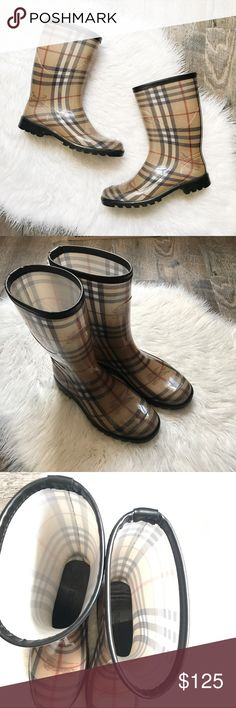 Burberry Plaid Check Haymarket Mid Rain Boots Plaid check Haymarket mid calf rain boots from Burberry. Size EU 37. Size US 7. Fits true to size. Great pre worn condition! Some slight wear to heels and bottoms. Also some scuffing on sides but this isn't very noticeable. Do not come with original box. No trades or try ons! Burberry Shoes Winter & Rain Boots