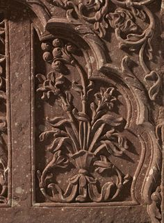 Carved panel with deep, cusped arch enclosing three sections with flowers, probably from a Mughal palace or haveli in Rajasthan, Mughal, late Aurangzeb-Muhammad Shah Period, c. 1680-1730