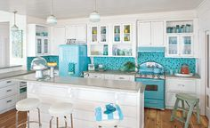This kind of makes me want to change my mind about my kitchen colors. .. Bright Retro Kitchen - Room Tour | Wayfair