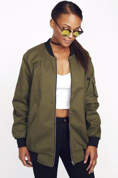 """- This amazing, great quality bomb jacket is 7% Cotton, 3% Spandex. - Dry Clean only - Imported - Model is wearing a size small-Model is 5""""8 with a 34"""" bust, 25"""" waist and 36"""" hips."""