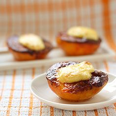 Cheesecake-Stuffed Peaches: juicy peach halves dipped in cinnamon & clove sugar then filled with cheesecake mixture. Eat same day it's made!