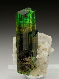 Chrome Dravite with Calcite from the very new find at Nadonjukin, Tanzania. Crystal Classics Minerals.