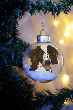This adorable ornament would make a great addition to any dog lovers tree. My hand drawn, originally designed, meticulously cut and floated paper Springer Spaniel is enclosed in a delicate glass bulb. The pup looks like it is just popping out of a snow bank to say hello!  You can have your ornament personalized (name and/or date added) on the outside of the glass bulb and shipped in a gift box!!!  **Please Read the whole listing before emailing me with questions or purchasing my bulbs and…
