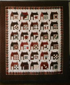 Schoolhouse quilt - I like how instead of windows on the side, each house has a different quilt block. I want to do a quilt like this