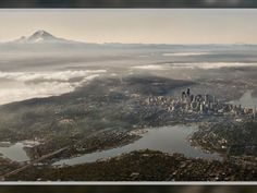 Snapped through a plexiglass window on an airline flight one September morning, ThatcherKelley captured a photograph of Seattle worth a thousand words. A photo that would help convince his wife they should move to Seattle, where he grew up.