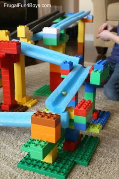 Building challenge for kids: Create a LEGO Duplo marble run with pool noodles. Makes a great engineering project for STEM learning! by frugalfunforkids #DIY #Marble_Run #STEM