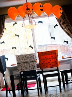 Holiday_HALLOWEEN_Chair back covers, dolling up the orange balloons. Fun, inexpensive.