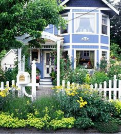 A profusion of blooms in what is usually an unused easement charms. The arbor and picket fence frame the look. (Check with your city or town for any restrictions on easement plantings.)