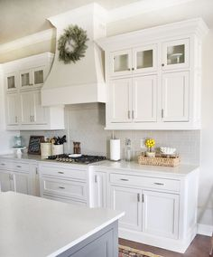 Beautiful Kitchen cooking area -  Virginia Quartzite countertops, island is painted SW Gauntlet Gray SW7019, shaker style cabinets with inset design painted Sherwin Williams SW7004 Snowbound, Frigidaire Gallery stove top, backsplash is H-line subway tile in Pumice with Dritwood grout color