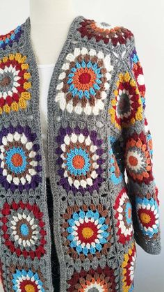 Hand Crochet Granny Square jacket coat cardigan for women. Made of squares in pa… Hand Crochet Granny Square jacket coat cardigan for women. Made of squares in patchwork style Made to order When you buy, send me information about your… Continue Reading → Crochet Coat, Knitted Coat, Knitted Dolls, Crochet Granny, Hand Crochet, Knitted Baby Clothes, Crochet Clothes, Hippie Crochet, Newborn Crochet