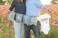 creative pregnancy announcement | Pregnancy announcement using a banner with cute onesie.