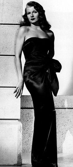 Rita Hayworth - love that black satin dress & elegance...