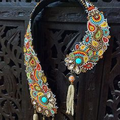 A truly unique, sculptural bead embroidery necklace with an exuberance of colorful seed beads, brass and silver metal beads hand sewn onto an