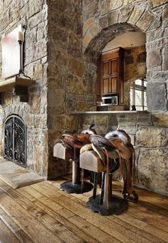 Stone walls and saddle bar stools, complete with plow disc braces