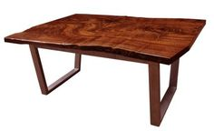 a claro walnut slab desk with a drawer and secret compartment blog post here