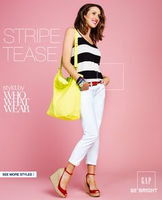 Basic black and white guarantees a crisp, classic outfit, but adding punchy highlights lends the look a vivacious (and very spring-appropriate) twist! A yellow canvas bag, cherry red belt, and red wedge heels liven up a striped tank top and cuffed white skinny jeans