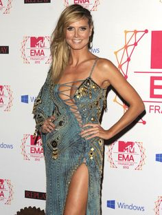 Heidi Klum at the 2012 EMAs. I think it goes without saying that this dress looks absolutely horrid from the single sleeve to the awkward bust lace-up.