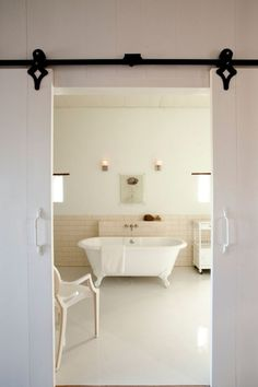 hang doors from a track to create sliding french doors.