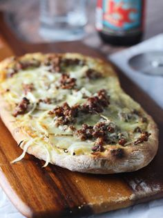 White Pizza with Roasted Garlic Sauce, Aged Cheddar, Potato and Italian Sausage