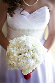 White bridal bouquet of hydrangea, orchids and callas by Marie Leigh Floral Design, Austin Texas
