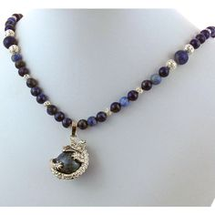 Sodalite Silver Dragon Natural Stone Pendant Necklace ($52) ❤ liked on Polyvore featuring jewelry, necklaces, natural stone pendant necklace, natural stone necklaces, peace necklace, beaded necklaces and long pendant necklace