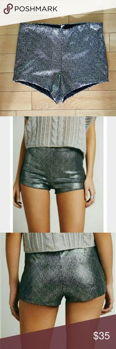 NEW! Free People silver/black sequin shorts sz S NWOT Free People silver/black sequin shorts. Side zip. Sz S  Brand new without tags.  Wear in summer or winter with tights! Free People Shorts