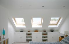 cupboard and bookcase mixed under eaves storage  Landmark Lofts - Loft Conversions London by landmarklofts, via Flickr