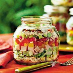 Layered cornbread and turkey salad in jar.