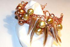 $50 Copper bracelet with fresh water pearls ; http://www.artfire.com/ext/shop/product_view/amijusARTdesign/4151062/_victory_bracelet_/Jewelry/Bracelets/Gemstone