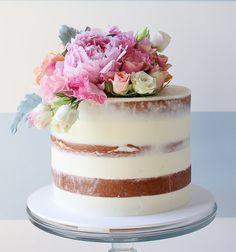 Semi naked layer cake with fresh flower topper #botaniccake #weddingcake #cakeflowers