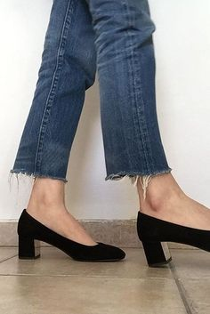 Frayed jeans and block kitten heels.