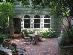 Aged brick patio in Atlanta Backyard Farming, Backyard Retreat, Backyard Patio Designs, Backyard Landscaping, Bungalow Landscaping, Outdoor Spaces, Outdoor Living, Cement Patio, Low Maintenance Landscaping