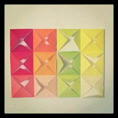 Origami wall art. DIY tutorial by How About Orange. http://howaboutorange.blogspot.com/2012/08/make-easy-diy-wall-art-from-folded-paper.html