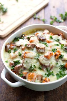 Sweet Potato, Kale, and Sausage Bake with White Cheese Sauce - comfort food featuring a handful of pantry staples and a few super healthy in...