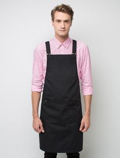 The Deluxe Canvas Bib Apron in Black is an industry favourite that is stylish, functional and sophisticated. With subtle detail in all the right places, the Deluxe Canvas Bib is the perfect staff uniform item that can be dressed-up with a tailored shirt or worn with a casual tee.  This designer apron is made from durable poly/cotton canvas, with cross-back straps, spacious front pocket and features metal hardware. Also available in White and Navy, and as a waist apron. Please refer to t...