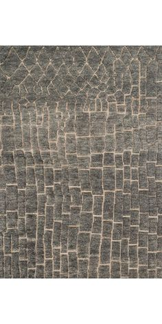 Hand-knotted in India of a jute base and wool pile this rug offers a subdued tribal feel with geometric motifs. The textural highs and lows loosely echo the stone paths and architecture of the old wor
