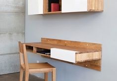Home Office Designs For Small Spaces.  Wall mounted office shelf and cubby system.
