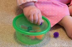Fitting Poms in Container 21 Activities for One Year Olds - Baby Play - Wildflower Ramblings Activities For One Year Olds, Quiet Time Activities, Indoor Activities For Kids, Infant Activities, Learning Activities, Airplane Activities, One Year Old Baby, Busy Bags, Early Literacy