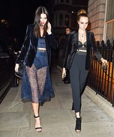 Left, Kendall Jenner wears a blue lace matching set with a velvet blazer and ankle-strap heels. Right, Cara Delevingne wears a lace bralette with high-waisted pants, booties, and a velvet blazer