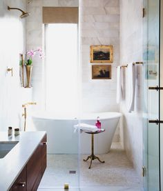 Bathroom with tub in shower.   Freestanding claw tub in shower room   Wet room with bathtub in shower.   Photo Gallery | The Dewberry Hotel in Charleston, SC