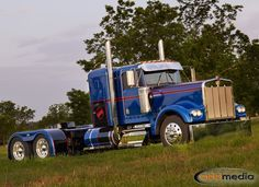 A fully tricked out and restored Kenworth W900B parked near 4State Trucks outside of Joplin, MO