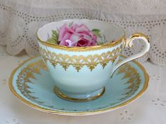 Pink Rose in a blue teacup