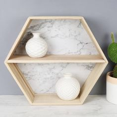 Lisa Angel Marble Effect Wooden Hexagon Wall Shelf (29 CAD) ❤ liked on Polyvore featuring home, home decor, small item storage, wooden ledge, geometric home decor, marble home decor, wood ledge and wooden home decor