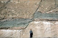 Photograph of faulted sedimentary rock layers exposed in a roadcut in Guatemala