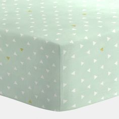 Crib Fitted Sheet in Mint and Gold Triangles by Carousel Designs.