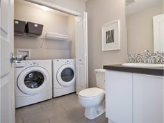 Thinking out efficient use of space, such as having laundry in a closet in the bathroom, helps with planning out a secondary suite. Laundry Bathroom Combo, Laundry Room Design, Downstairs Bathroom, Bathroom Layout, Small Bathroom, Bathroom Ideas, Bathroom Organization, Basement Laundry, Laundry Closet