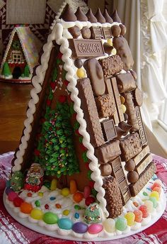 Amazing chocolate candy cottage!  Dishfunctional Designs: Gingerbread House Inspiration