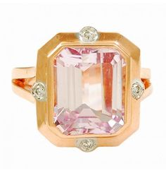 Pink Kunzite and Diamond Ring  A gorgeous ring made of 18k pink gold featuring an unusual stepped emerald cut pink Kunzite embellished with dIamonds