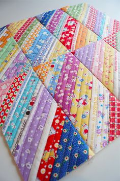 Samelia's Mum: Sewing with scrappy strips and selvedges - Quilt As You Go Method really works for this type of project.